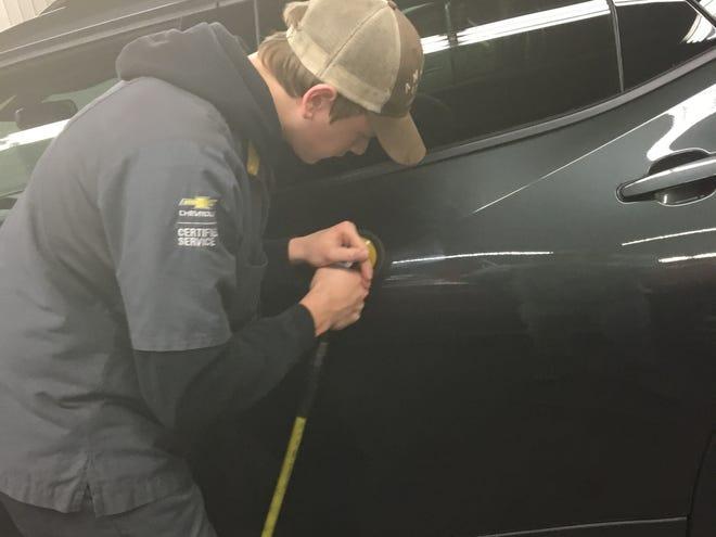 Luxemburg-Casco High School senior Austin Tank works on a car as part of his youth apprenticeship at Gandrud Chevrolet.