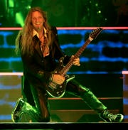 Guitarist Joel Hoekstra performs with Trans-Siberian Orchestra during the first of two shows Nov. 13 at the Resch Center in Ashwaubenon.