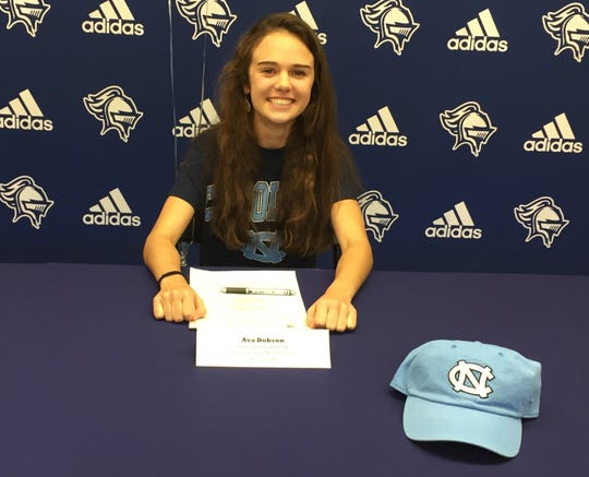 St. Joseph's cross country runner Ava Dobson signs her national letter of intent to continue her running career at North Carolina.