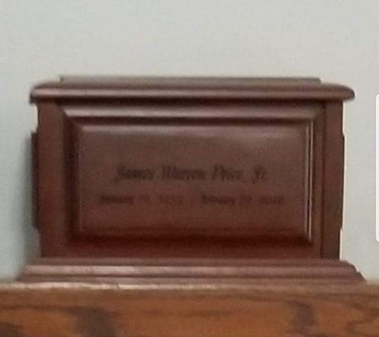 An urn with the name James Warren Price Jr. was among items stolen out of a traveler's vehicle recently in Great Falls, according to police.