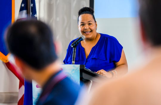 Mona McManus, Oasis Empowerment Center executive director, explains the role the organization plays in the assistance, treatment and recovery of its clients who struggle to overcome alcohol and drug addiction, as she addresses Rotary Club of Guam members during their luncheon at the Outrigger Guam Beach Resort in Tumon on Thursday, Nov. 14, 2019.