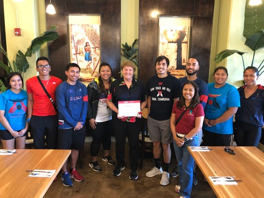 Josephine Pinto, center, was honored for her service to world athletics within the International Association of Athletics Federation. She has been active in local track and field since 1985.