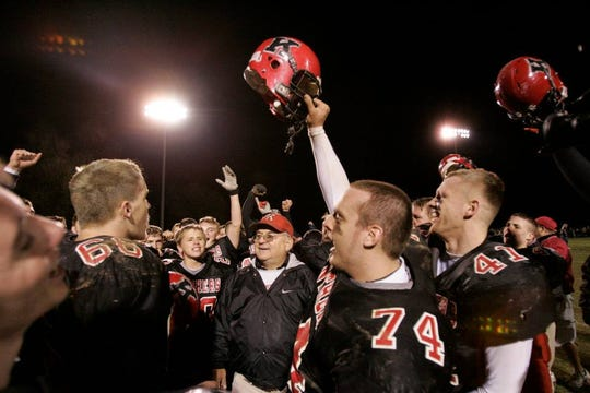 Don Willard surrounded by his Knightstown players.
