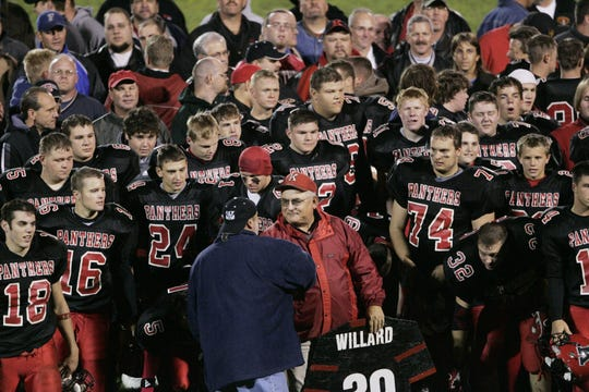 Don Willard mingled with his players from the past 39 years on the field after his last regular season game.