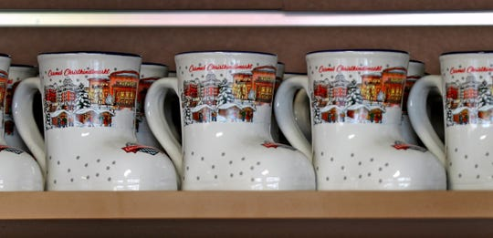 The 2019 glühwein mugs are seen during the Carmel Christkindlmarkt soft opening, Wednesday, Nov. 13, 2019. This year's collectible mugs are white. The festival runs Nov. 16 through Dec. 24 in Carmel.