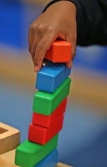 A child builds a stack of blocks at IU Health Day Early Learning Center, Thursday, Nov. 14, 2019.  Early Learning Indiana has been in business of providing care for 120 years.  It runs nine child care centers around Marion County.