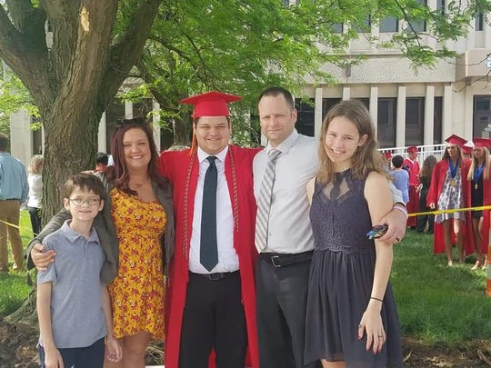 Craig McLin today surrounded by his family (from left) son William, wife Angela, son Lucas, McLin and daughter Ella.