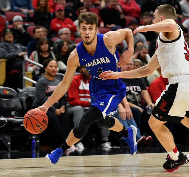 Nov 13, 2019; Louisville, KY, USA; Indiana State Sycamores guard Cooper Neese (4) dribbles against Louisville Cardinals guard Ryan McMahon (30) during the first half at KFC Yum! Center.