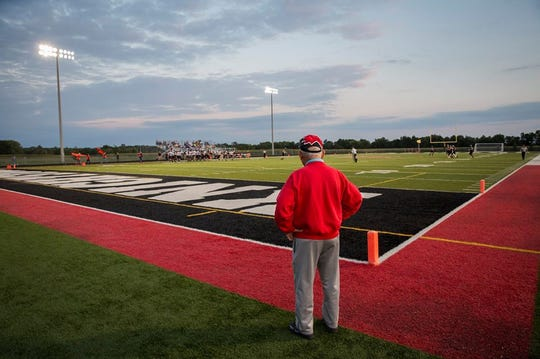Don Willard looks out on the football field that bears his name.