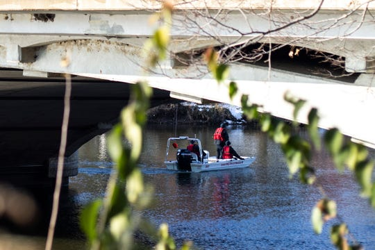University of Iowa police, Iowa City fire and the Johnson County Sheriffs search under the Iowa Avenue Bridge, Thursday, Nov., 14, 2019, on the Iowa River in Iowa City, Iowa.
