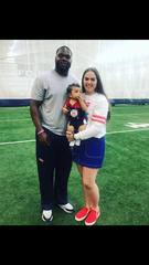 Austrian Robinson and Torri Lewis pose with their son A.J. at the Ole Miss football practice facility.