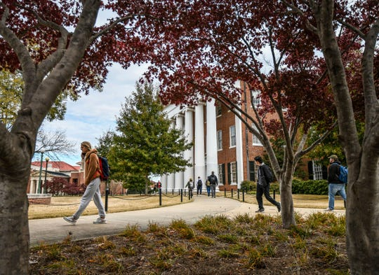 University of Mississippi students walk across campus in Oxford, Miss. on Thursday, Nov. 14, 2019.