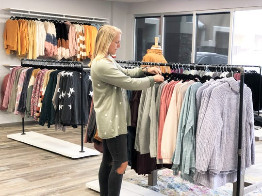 """""""I like the aspect of helping customers find an outfit for senior pictures – the personal shopping and styling of the business,"""" said Kaitlyn Howell, owner of Salt & Pepper, a new Fountain City boutique."""
