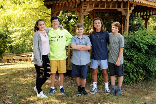 """This picture will serve as a reminder of how fortunate I am to be a teacher at Gresham Middle, where the seemingly impossible is possible,"" said Alice McManus, eighth grade ELA teacher. The photo has been enlarged and will be featured on the walls of Gresham. From left, Paris Martinez, her brother Jean-Gabriel (J.G.), Zach Turner, Kai Litton and Wylder Lee."
