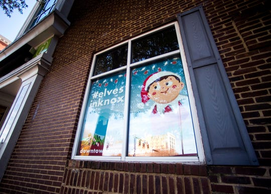 A sign for downtown Knoxville's Elf on the Shelf Scavenger Hunt hangs in the window of Visit Knoxville's Visitor Center on Thursday, November 14, 2019.