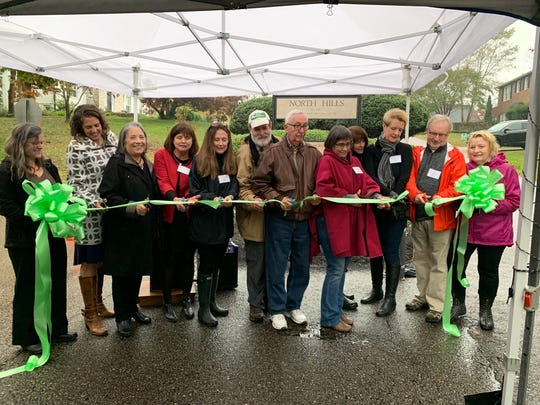Kris Mahoney, Mayor-elect Indya Kincannon, Mayor Madeline Rogero, Sally Wilcox, Eleanor Kilpatrick, Tom Welborn, Lloyd King, Judi Talley, Maggie Bell, Louise Franks, Mike Patterson and Gail Burnett cut the ribbon on the new North Hills Arboretum. 11/7/19