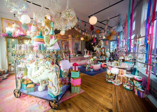 Traditional decoratorswon't find much red and green decor in Glitterville, at 701 Worlds Fair Park. Instead it's a whimsical pastel explosion featuring pinks, blues and greens.