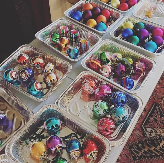 Take stock and organize ornaments before decorating, suggested Help You Dwell co-founder Taryn McLean. Organizing ornaments by theme or color, especially if decorating multiple trees, can simplify the process. Contain them in disposable foil trays to help create a balanced look for each tree and minimize breakage, she said.