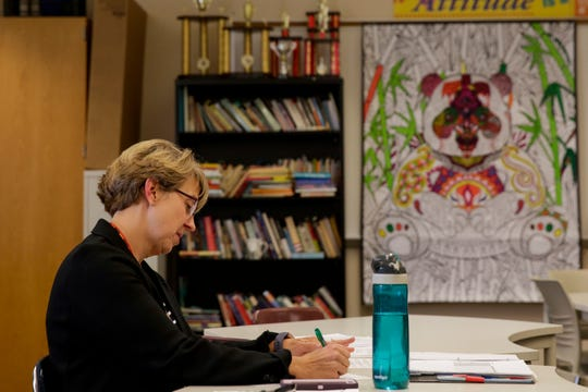 Laura Whitcombe grades one of her Advance Speech Dual Credit students as they give an impromptu speech, Thursday, Nov. 14, 2019, at McCutcheon High School in Lafayette.