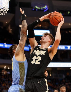 Nov 13, 2019; Milwaukee, WI, USA; Purdue Boilermakers center Matt Haarms (32) shoots against Marquette Golden Eagles forward Theo John (4) during the second half at Fiserv Forum. Mandatory Credit: Jeff Hanisch-USA TODAY Sports