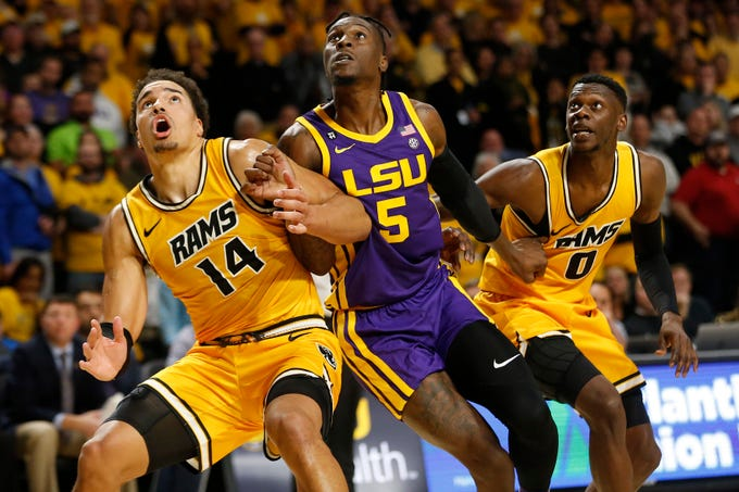 Nov 13, 2019; Richmond, VA, USA; Virginia Commonwealth Rams forward Marcus Santos-Silva (14), LSU Tigers forward Emmitt Williams (5) and Rams guard De'Riante Jenkins (0) battle for position for a rebound in the second half at Stuart C. Siegel Center. Mandatory Credit: Geoff Burke-USA TODAY Sports