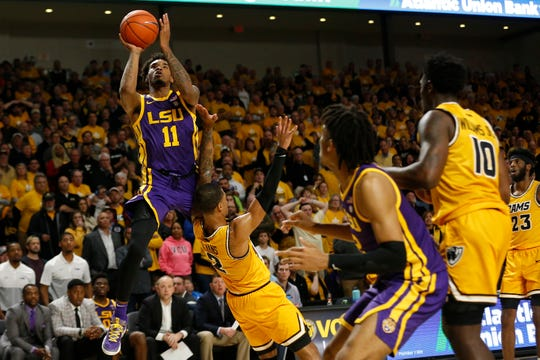 Nov 13, 2019; Richmond, VA, USA; LSU Tigers guard Charles Manning Jr. (11) shoots the ball while being fouled by Virginia Commonwealth Rams guard Marcus Evans (2) in the second half at Stuart C. Siegel Center. Mandatory Credit: Geoff Burke-USA TODAY Sports
