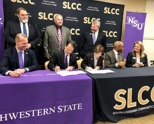 South Louisiana Community College and Northwestern State University officials sign an agreement Thursday creating a pathway from SLCC's associate degree program in civil survey and mapping to NSU's bachelor degree program in resource management with a concentration in GEO computation at NSU.