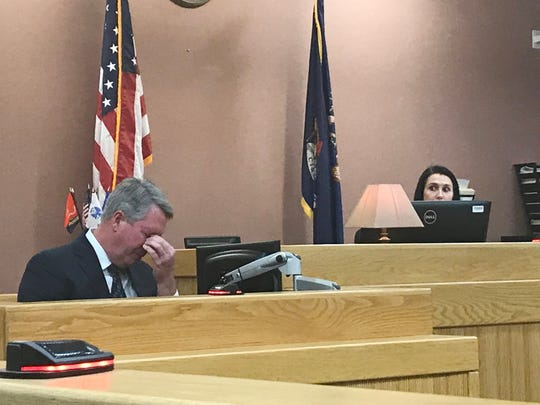 Dr. Edward Washabaugh becomes emotional as he testifies Thursday, Nov. 14, 2019 in a hearing for two men charged with second degree murder for producing tainted steroids.