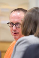 Barry Cadden talks to his attorney Michelle Peirce in a preliminary hearing Thursday, Nov. 14, 2019 in Judge Shauna Murphy's courtroom on numerous meningitis deaths.