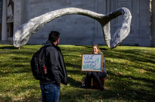 Courier Journal reporter Maggie Menderski talked to a student passing by in front of the wishbone sculpture at the Speed Art Museum. November 14, 2019.