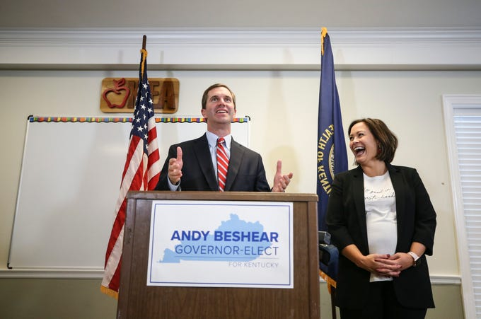 Governor-elect Andy Beshear and his Lt. Governor-elect Jacqueline Coleman share a laugh at the KEA headquarters in Frankfort while greeting the press after the recanvass results which confirmed he was the 2019 election winner over Governor Matt Bevin  Nov. 14, 2019