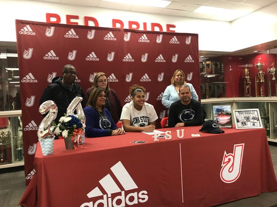 Nan Garcia poses with her family after signing with Penn State