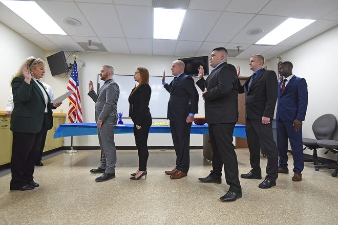 Safety-Service Director Lori Cope swears in six new officers to the Mansfield Police Department on Thursday morning.