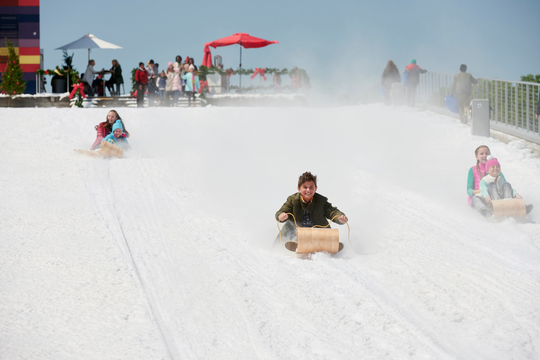 "The sloped roof of Beale Street Landing was transformed into a credible snow-covered sledding hill during the July production of ""Christmas at Graceland: Home for the Holidays."""
