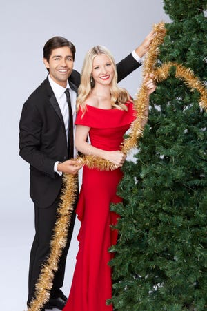 "Adrian Grenier and Kaitlin Doubleday will probably misplace those garlands if they don't quit staring straight ahead as they strike a pose for ""Christmas at Graceland: Home for the Holidays."""