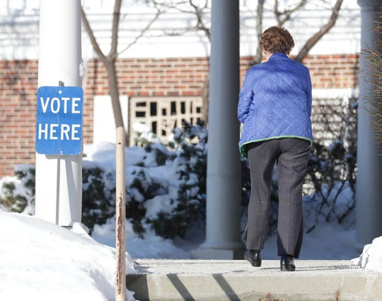 A voter walks into Lumen Christi Parish on in Mequon Feb. 19.