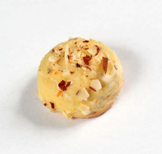 Orange Almond Ricotta Cookies are topped with tiny bits of sliced almonds.