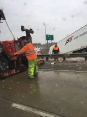 Wrecker crews work to remove a crashed semi from the I-41/Highway 145 interchange on Thursday morning. The crash caused big backups on southbound I-41 during the Thursday morning commute.