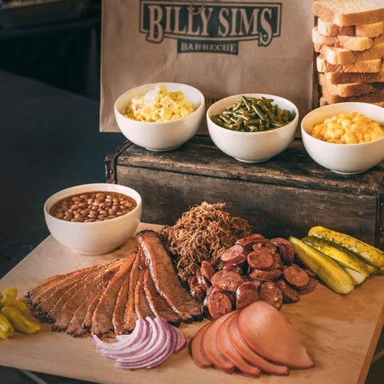 Billy Sims Barbecue restaurants smoke meats over pecan-wood fires daily, including brisket and pork shoulder.