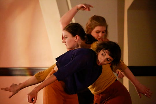 """Mauriah Kraker, front, Lindsey Ruenger and Amanda Laabs dance in Wild Space's """"Everything in its Place"""" at the Echelon Ballroom in Wauwatosa."""