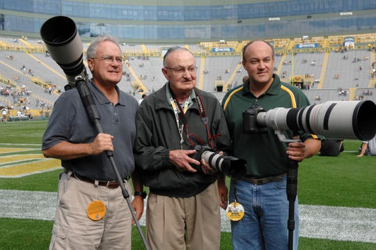 The Bievers (from left) John, Vernon and Jim pose for a photo at Lambeau Field in 2006. Vernon or Jim took photos for the Packers from 1941 to 2015.