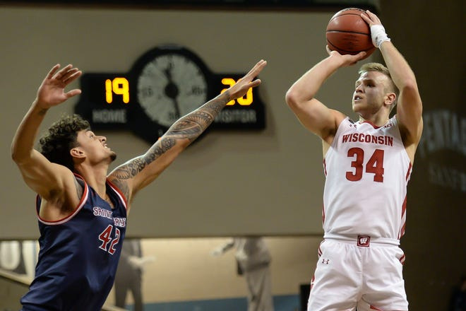 Guard Brad Davison, shown in a previous game, led Wisconsin with 24 points Wednesday night.