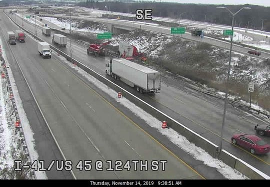 This freeway camera image shows crews removing a jackknifed semi along southbound I-41 at the Milwaukee-Waukesha county line.