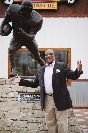 Heisman Trophy winner and former Detroit Lions running back Billy Sims will be at the grand opening of Billy Sims Barbecue in West Bend on Nov. 15 and 16. The franchise is the first in Wisconsin for the chain.