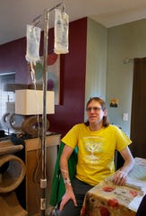 Corey Sukalich gets an IV infusion at his home. Sukalich suffers from Dysautonomia, a stealth disease in that the symptoms are not easy to spot and doctors aren't especially aware of it.