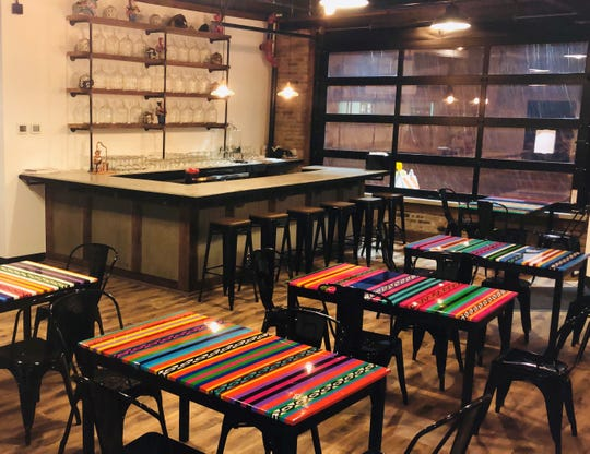 The dining room at Triciclo Peru, 3801 W. Vliet St., has tabletops hand-painted to resemble Peruvian tapestries. The restaurant is due to open Dec. 4.