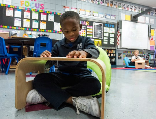 Forest Avenue School pupil Karter Stoudmire uses flexible seating for reading at the school in Montgomery on Thursday November 14, 2019.