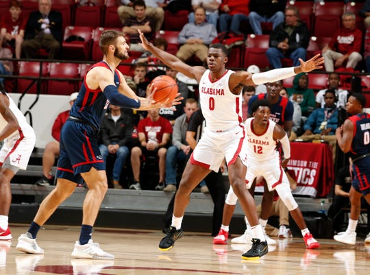 Alabama redshirt freshman forward Javian Davis (0) plays defense during Monday night's 78-59 win over Florida Atlantic on Nov. 11, 2019 from Coleman Coliseum in Tuscaloosa.