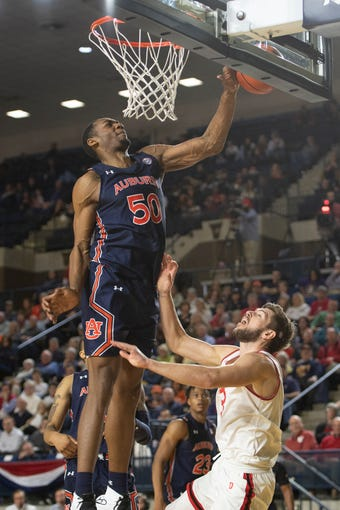 Nov 8, 2019; Annapolis, MD, USA;Auburn Tigers center Austin Wiley (50) blocks Davidson Wildcats guard Jon Axel Gudmundsson (3) shot during the second half at Alumni Hall. Mandatory Credit: Tommy Gilligan-USA TODAY Sports
