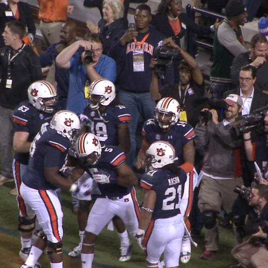 Auburn defensive tackle Derrick Brown (top, center, in blue hoodie) records the Tigers scoring the Prayer at Jordan-Hare to defeat Georgia on Nov. 16, 2013, while on a recruiting visit.